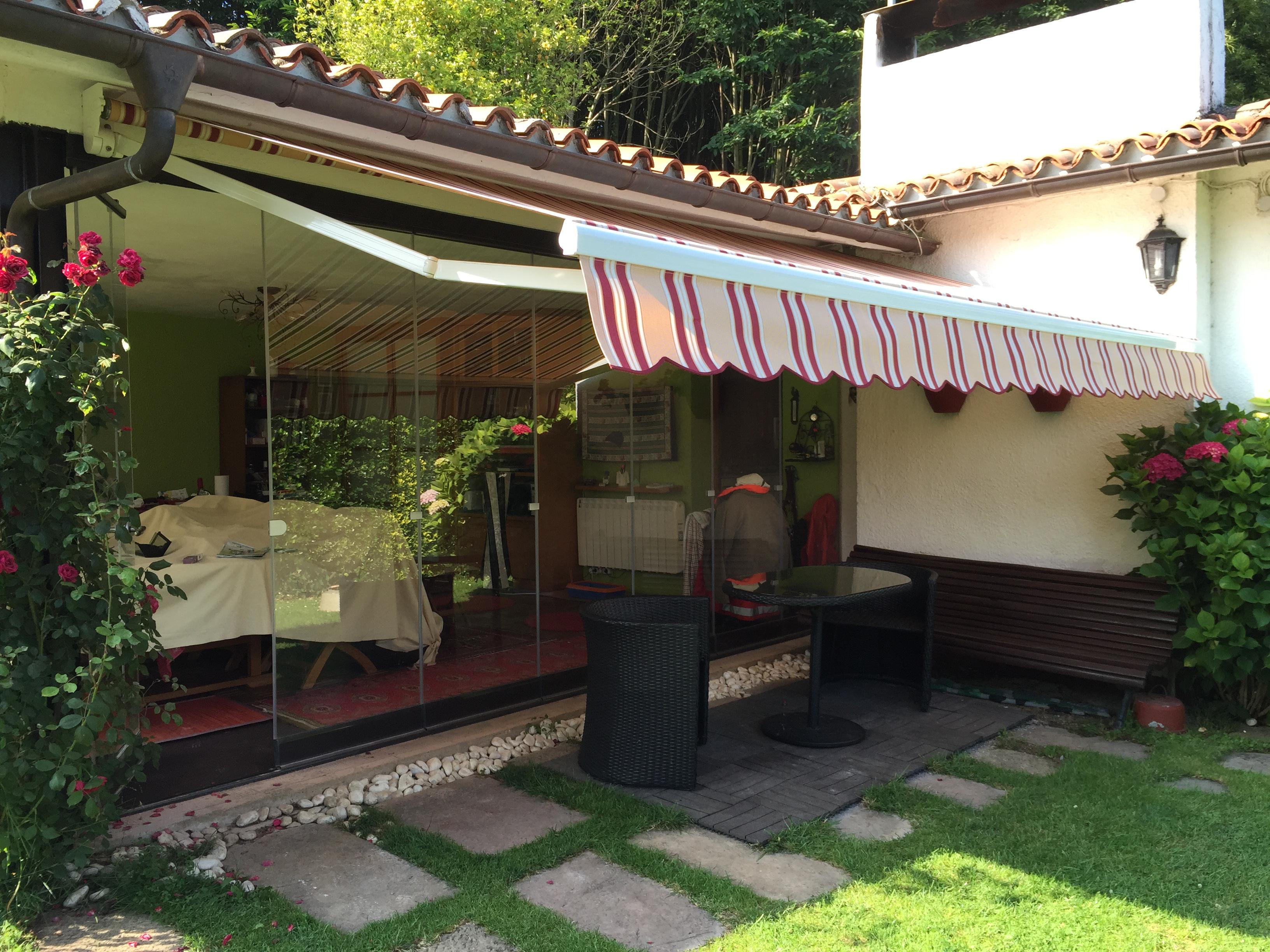 Toldos en asturias llanera toldos para jard n toldos for Tendedero jardin